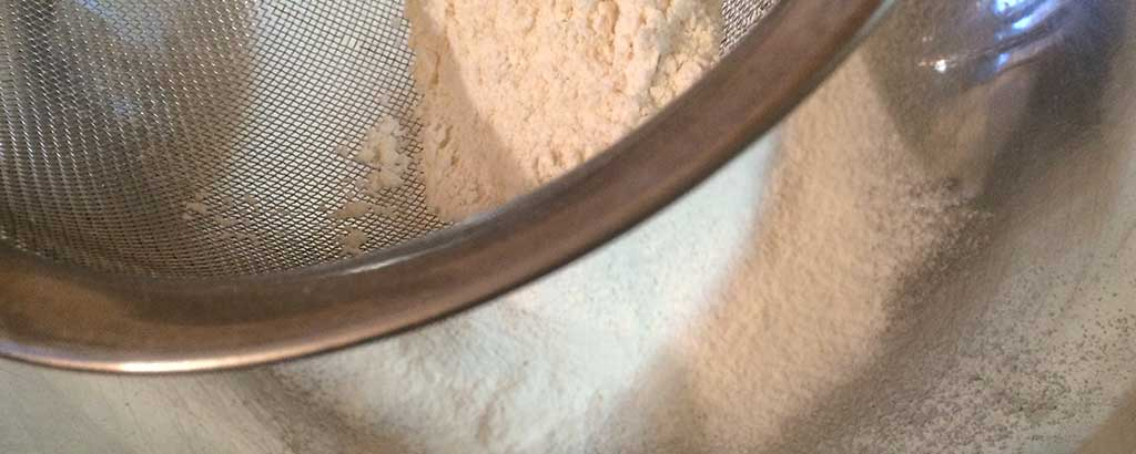 Sift flour for biscuit bites