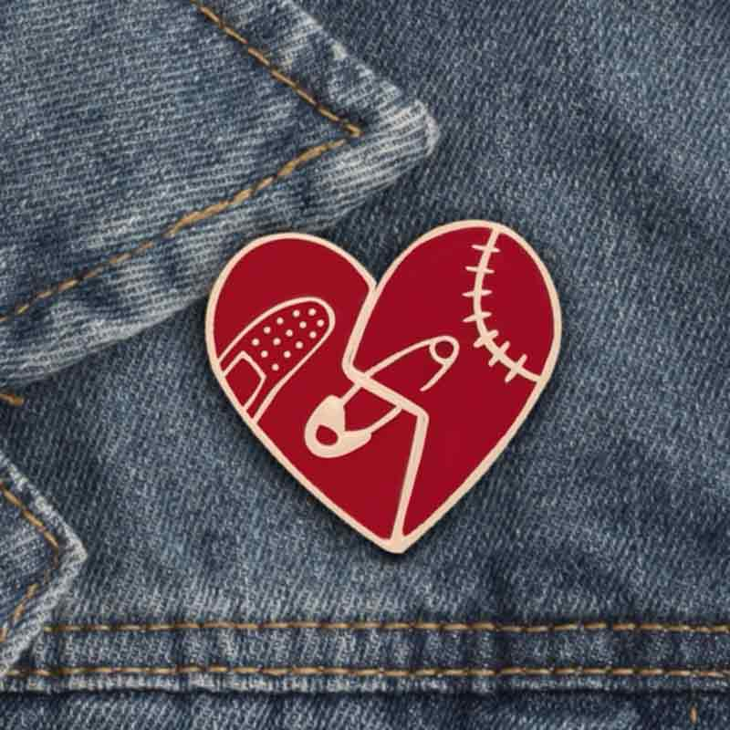 Wearing Mended Broken Heart Lapel Pin