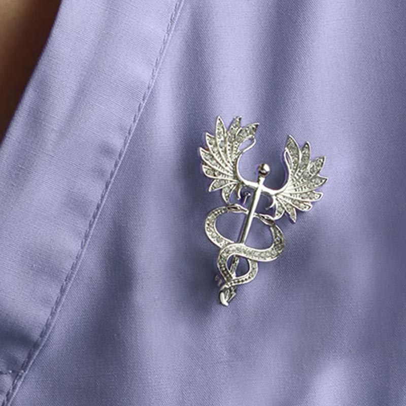 Wearing Big Wing Caduceus Silver and Crystal Lapel Pin