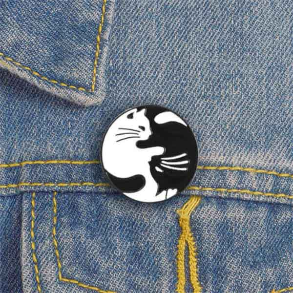 Cats B+W Enamel Lapel Pin on Denim