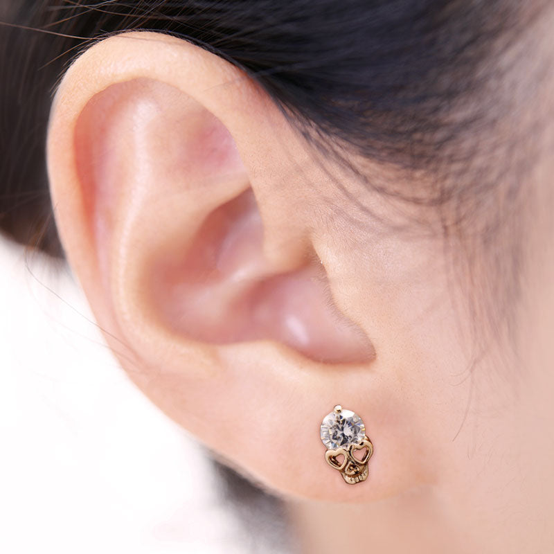 Wearing Gold Skull CZ Earring Stud