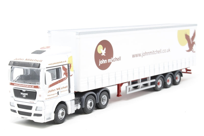 "MAN TGX XXL Curtainside ""John Mitchell"". Production run of 2000 - Pre-owned - Like new"