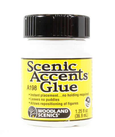 Scenic Accents glue. Stays tacky - prevents snapping of figures