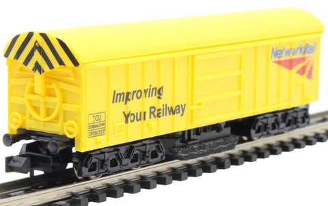Bogie track cleaning wagon in Network Rail yellow