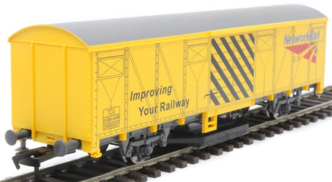 Track cleaning wagon in Network Rail yellow