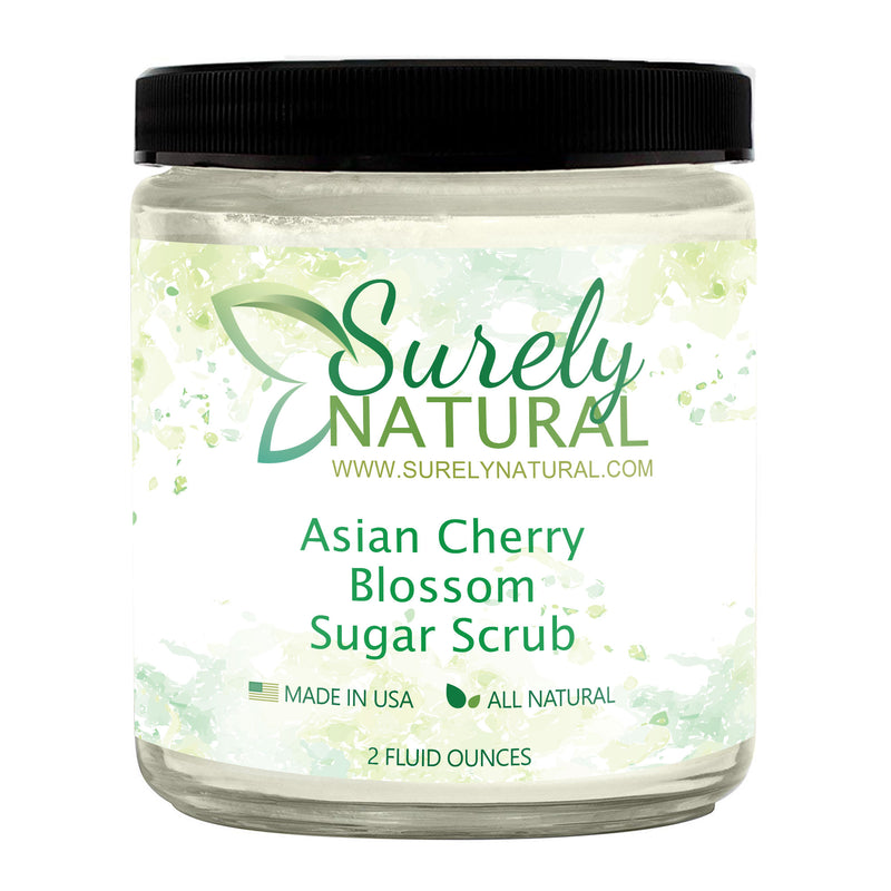 A jar of natural sugar scrub with floral cherry blossom fragrance from Surely Natural