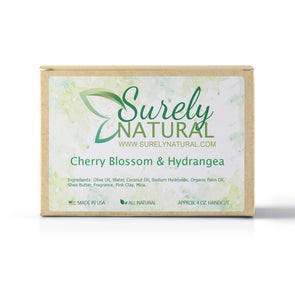 A packaged bar of cherry blossom and hydrangea scented artisan soap, handcrafted by Surely Natural
