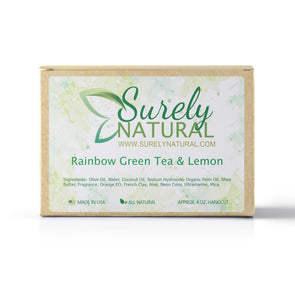 A packaged bar of green tea and lemon scented artisan soap, handcrafted by Surely Natural