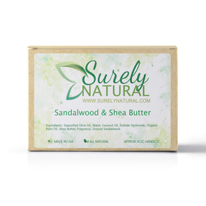 A packaged bar of sandalwood and shea butter scented artisan soap, handcrafted by Surely Natural