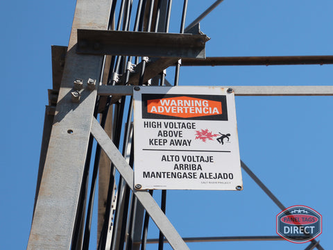 Color Danger Sign Mounted On Electrical Tower