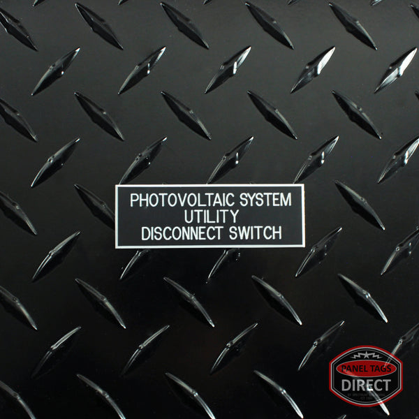 "White on Black Panel Tag - ""Photovoltaic System Utility Disconnect Switch"" (3 lines)"