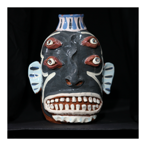 """Black Doubled Eyed"" Face Jug with White Lips"