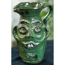 """Green Face Pitcher"""