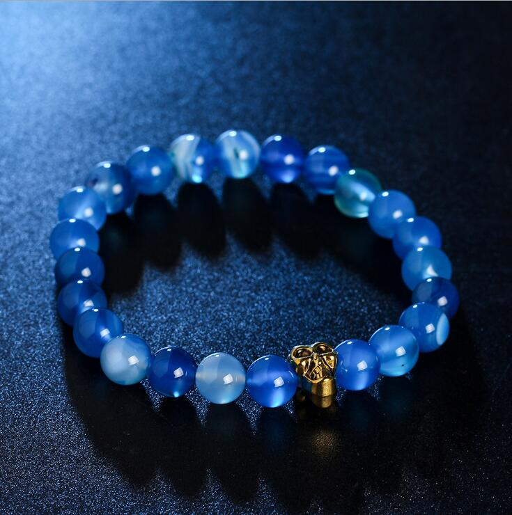 GOLDEN SKULL BLUE BOTSWANA AGATE GEMSTONE BEADS STRETCH BRACELETS
