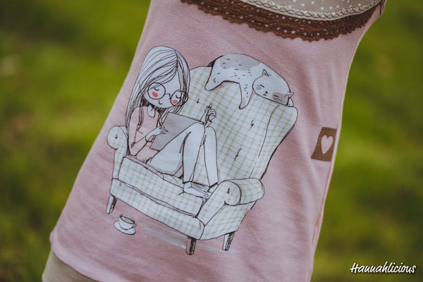 N688 Girl Reading in Chair Child Panel (On Pink)