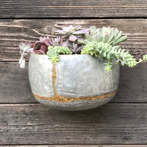wall planters made from heavy galvanized iron sheets and embellished with brass beading and brazing.