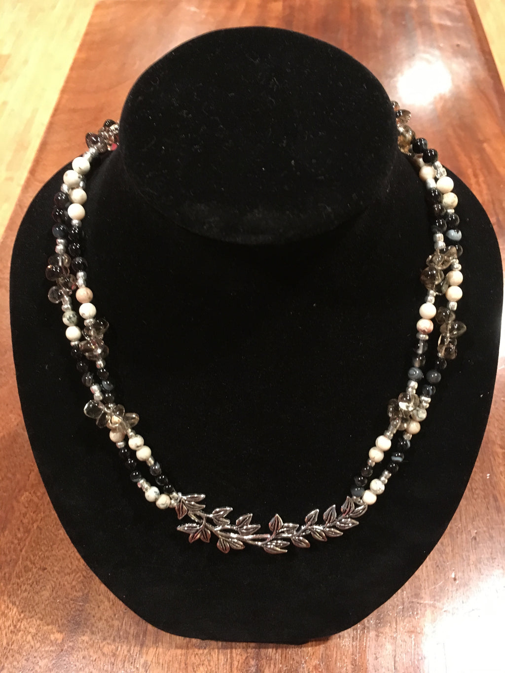 Double strand gemstone bead necklace with branch focal connector