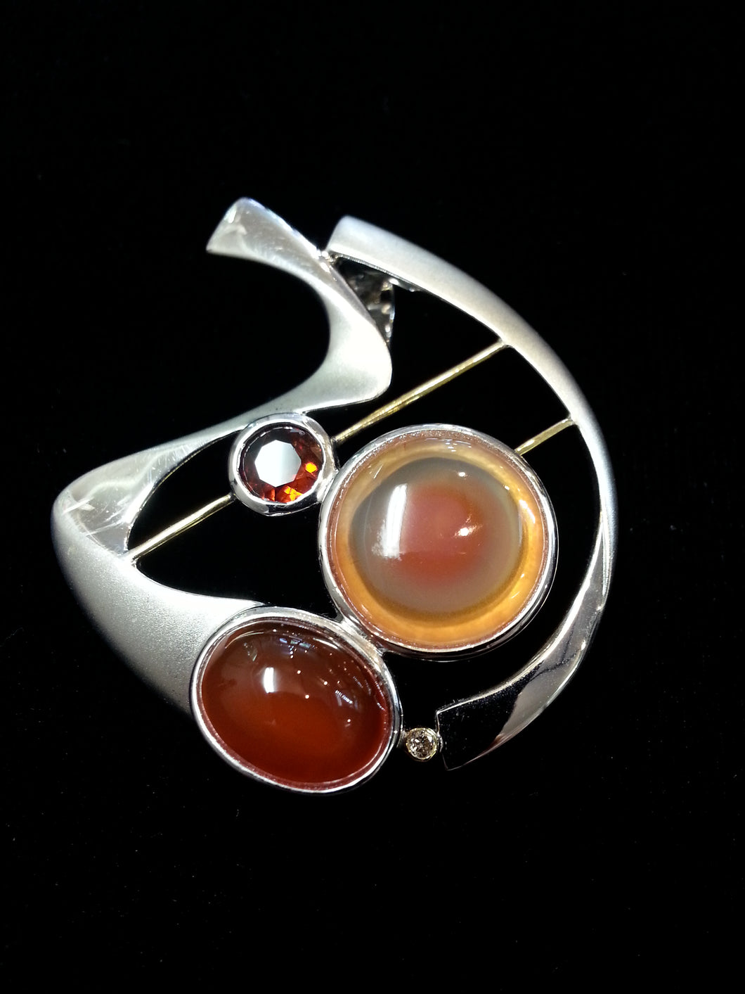 Pendant made with carnelian, agate, garnet, diamond.