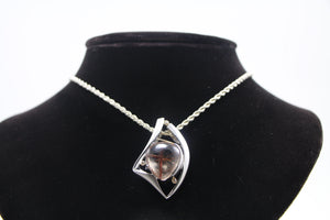 Rutilated Quartz and Diamond Pendant