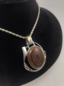Agate pendant, with diamond accent stones.