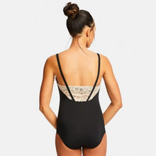 Rear view of a dancer wearing a black Capezio leotard with a low back and a nude