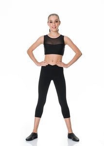 Girl standing with hands on hips wearing Studio 7 3/4 length black leggings and crop top
