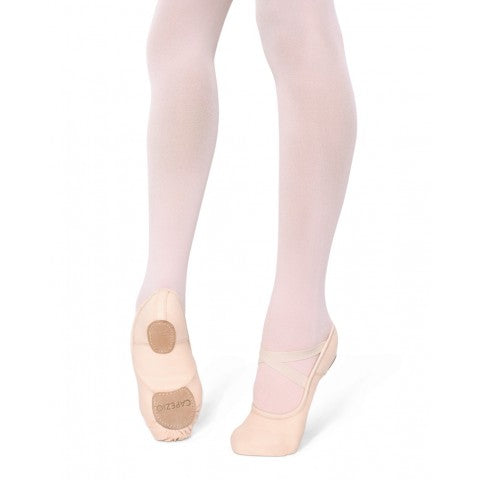 Bottom part of dancer's legs with feet on demi pointe showing front and sole of Capezio Hanami canvas ballet shoes