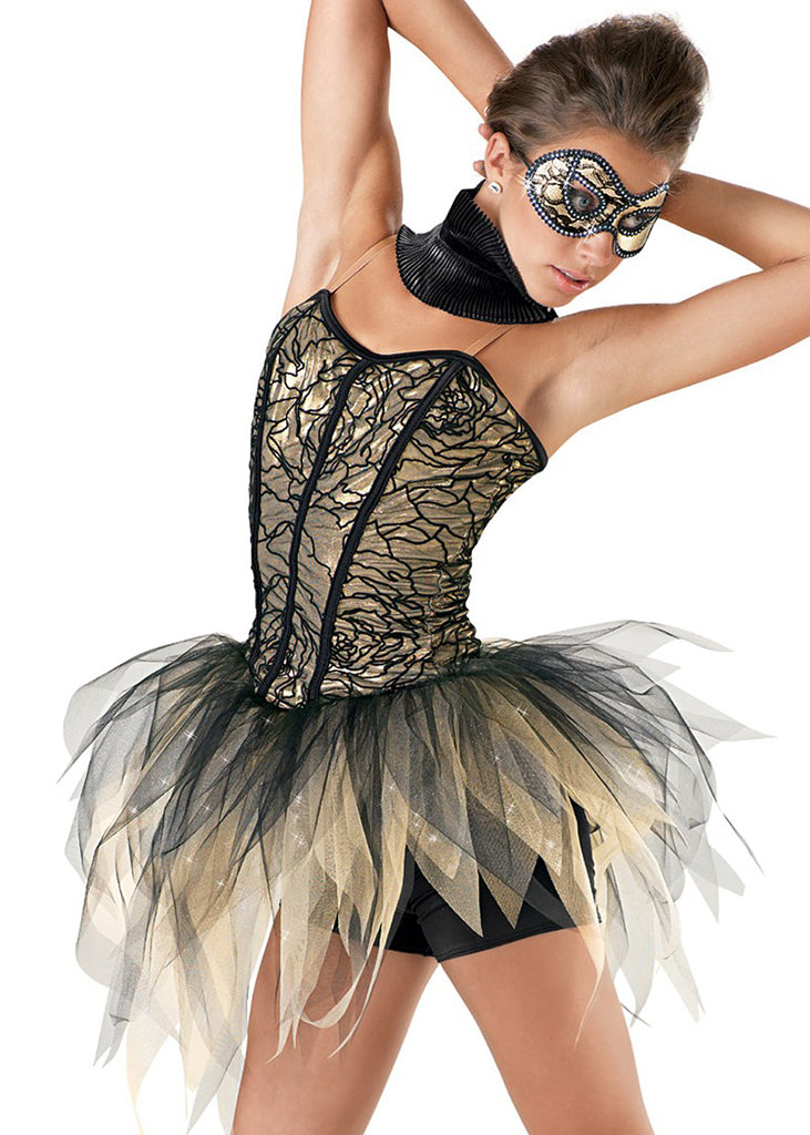Dancer with hands behind her head looking down wearing a lace corset style costume with shredded tulle skirt and a masquerade style eye mask