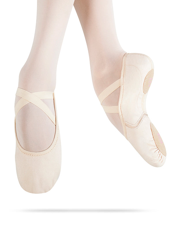 Dancer jumping in MDM Instrinsic canvas ballet shoes showing feet and ankles