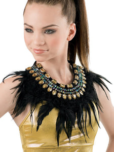 Girl in a gold top wearing a large black feather neckpiece