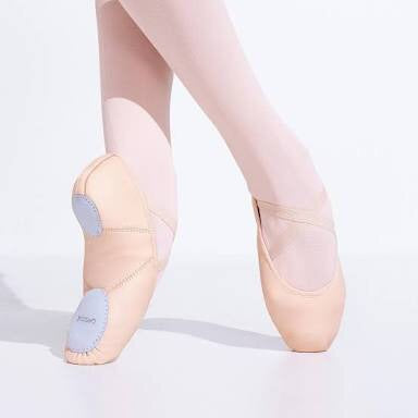 Ballet feet wearing Capezio Juliette leather split sole ballet shoe one foot turned to show sole detail