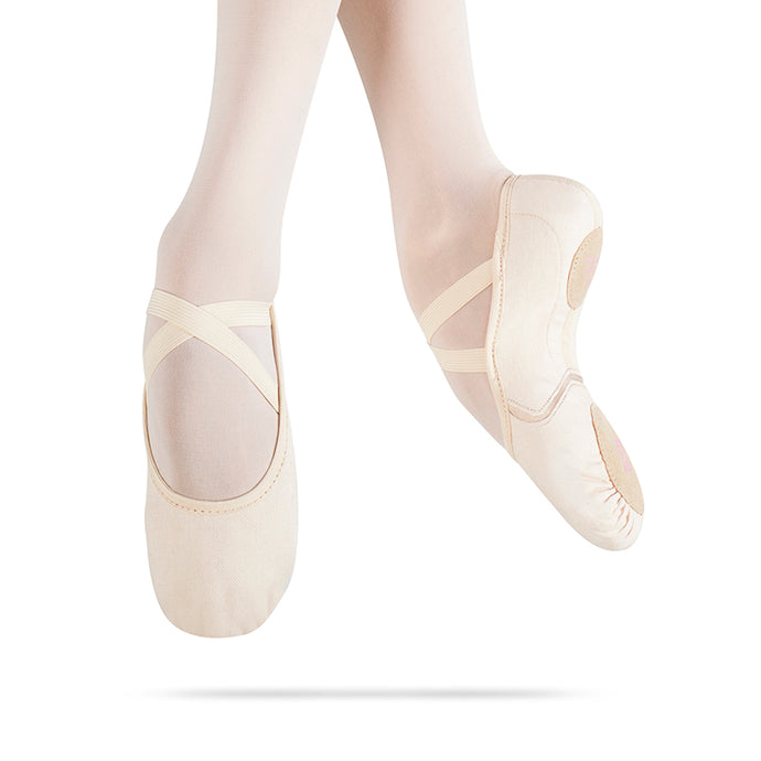 MDM Intrinsic canvas ballet shoe shown on dancers pointed feet.