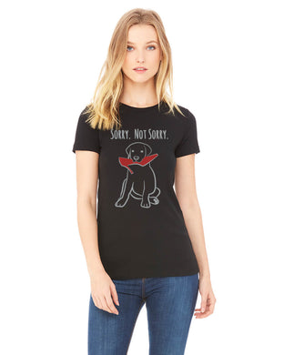 Black colored T-shirt that has a puppy with a high heel in it's mouth on it and the words 'Sorry Not Sorry' underneath