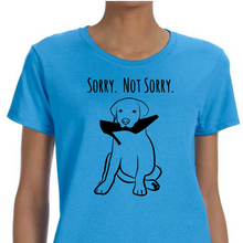 Blue colored T-shirt with a puppy chewing on a high heel shoe on it and the words 'Sorry Not Sorry' above