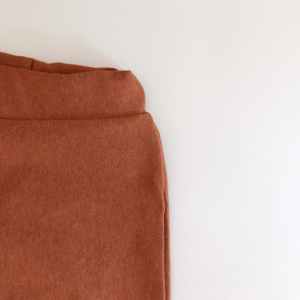 close up of waist band showing elastic encased in the soft terracotta material