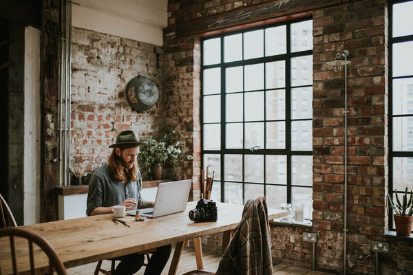 trendy business interiors with exposed brick walls