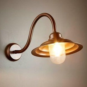 Liverpool Dark Brass Outdoor Wall Lamp turned on  from SMITH&SMITH