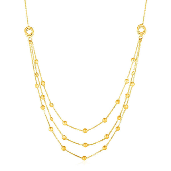 Station Necklace with Three Chains and Love Knots in 14k Yellow Gold