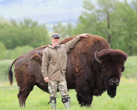 Troy Westre stands proudly next to one of his largest bison.