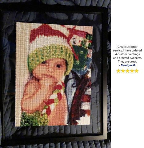 Image of 5 Star review of a DIY custom diamond painting of a baby in a cute bonnet from Heartful Diamonds