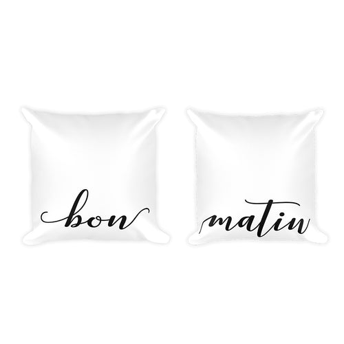 Two Black and White Pillows read bon matin or good morning in French