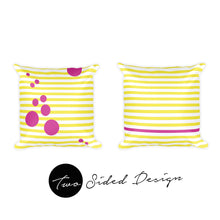 two pillows with pink and yellow stripes and circles