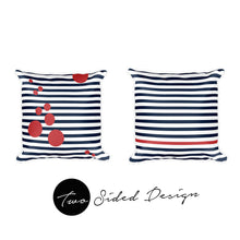 Two pillows with different designs stripes and spots