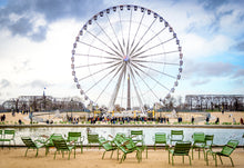 Paris Ferris Wheel with Empty Green Chairs