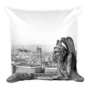 Gargoyle of Notre Dame looking over city of Paris