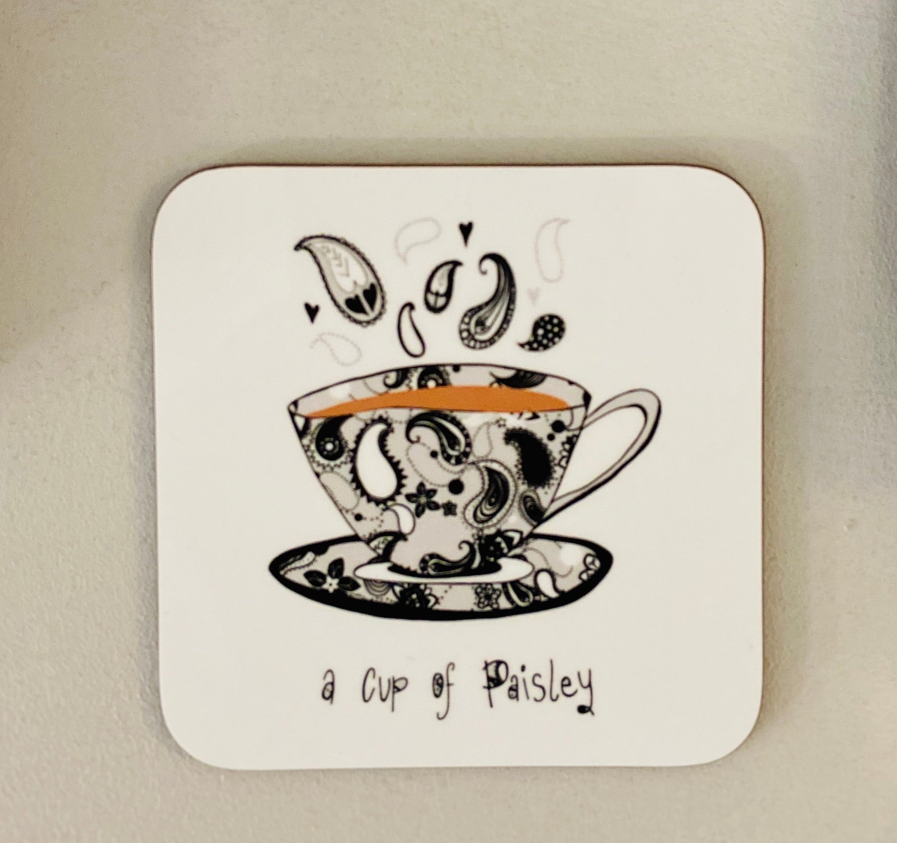 A cup of Paisley Coaster-Black & White