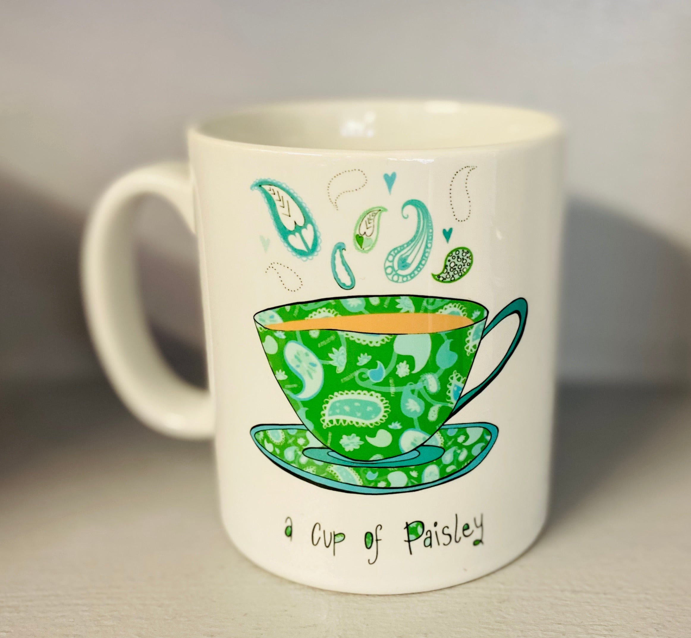 A cup of Paisley Mug-Green