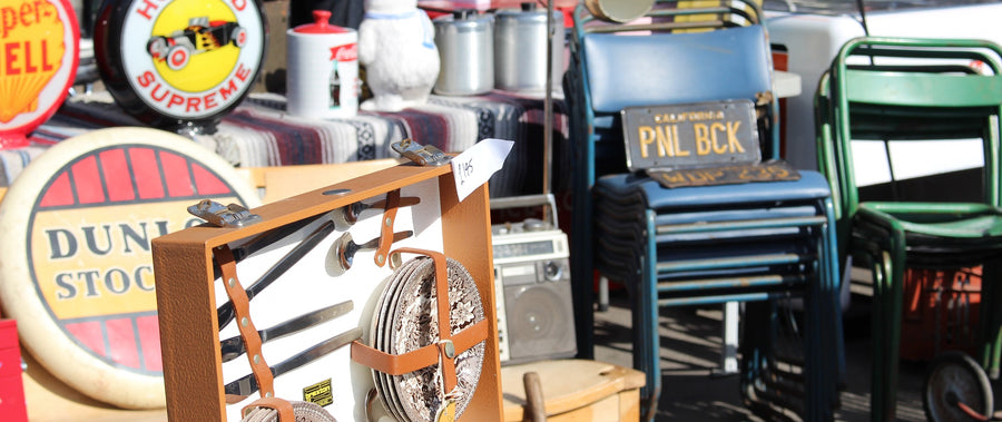 vintage antique market on sunny day, showing chairs, memorabilia, lots of colour and interest