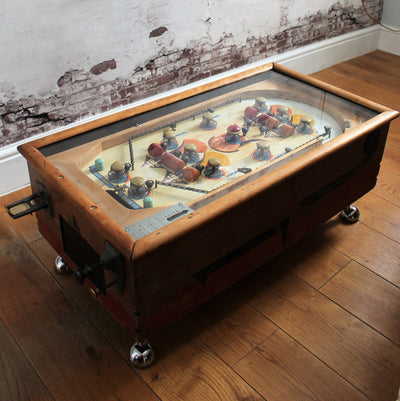 lose up of pinball machine coffee table showing original brass levers and knobs and lovely original colours orange, yellow blue