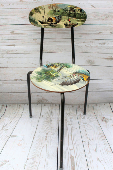 3 legged little chair showing canvas artwork to seat and back area, depicting chinese fishing boats